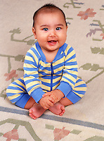 Portrait of a young, smiling Asian-American baby.