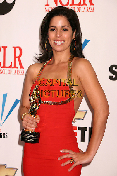 ANA ORTIZ.2007 NCLR ALMA Awards at the Pasadena Civic Center, Pasadena, California, USA..June 1st, 2007.half length red gold halterneck award trophy dress hand on hip.CAP/ADM/BP.©Byron Purvis/AdMedia/Capital Pictures