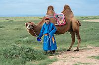 Mongolia, Gobi Gurvan Saikhan National Park, Gobi Desert, Motsog Els, nomad family riding camels.