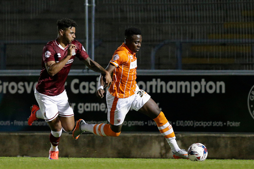 Blackpool's Bright Osavi-Samuel evades the challenge of Northampton Town's Josh Lelan<br /> <br /> Photographer Craig Mercer/CameraSport<br /> <br /> Football - Capital One Cup First Round - Northampton v Blackpool - Tuesday 11th August 2015 - Sixfields Stadium - Northampton<br />  <br /> &copy; CameraSport - 43 Linden Ave. Countesthorpe. Leicester. England. LE8 5PG - Tel: +44 (0) 116 277 4147 - admin@camerasport.com - www.camerasport.com