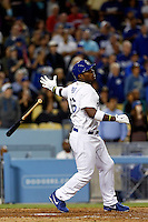 Yasiel Puig #66 of the Los Angeles Dodgers tosses his bat after hitting a grand slam home run during a game against the Atlanta Braves at Dodger Stadium on June 6, 2013 in Los Angeles, California. (Larry Goren/Four Seam Images)