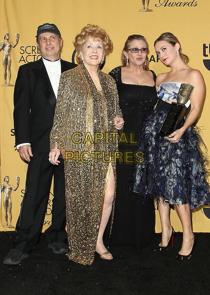 LOS ANGELES, CA - JANUARY 25: Todd Fisher, Debbie Reynolds, Carrie Fisher and Billie Lourd at the 21st Annual SAG Awards Press Room in Los Angeles, California on January 25, 2015 . <br /> CAP/MPI/FS<br /> &copy;FS/MPI/Capital Pictures