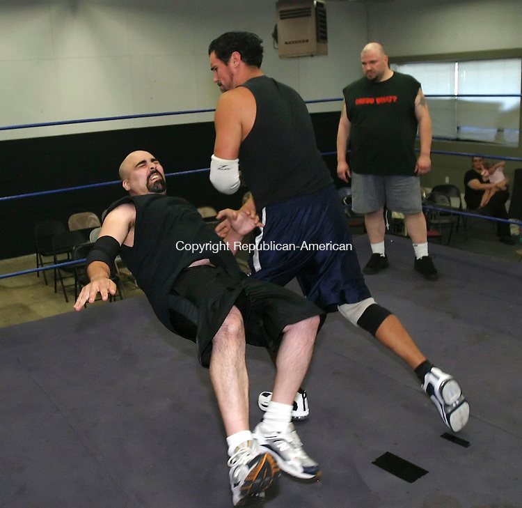 WATERBURY, CT 7/2/07- 070207BZ09- Pat Martino is slammed to the mat by Pat Gunner wrestle during practice at The Proving Grounds Wrestling School on East Main Street in Waterbury. The school is part of Defiant Pro Wrestling.  In the background is Bull Dredd.<br /> Jamison C. Bazinet Republican-American