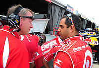 May 1, 2009; Richmond, VA, USA; NASCAR Sprint Cup Series driver Juan Pablo Montoya (right) talks with a crew member during practice for the Russ Friedman 400 at the Richmond International Raceway. Mandatory Credit: Mark J. Rebilas-