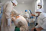 Doctors perform hemorrhoid surgery on a detainee at a facility for prisoners with tuberculosis located outside Baku, Azerbaijan.