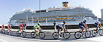 The peloton ride past Savona Harbour during the 2016 Milan-San Remo race, running 293km from Milan to San Remo, Italy. 19th March 2016.<br /> Picture: ANSA/Claudio Peri | Newsfile<br /> <br /> <br /> All photos usage must carry mandatory copyright credit (© Newsfile | Claudio Peri)
