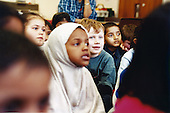 Owen Wood, 6, sits amid non-white students at a primary school in Leicester. ..Leicester is expected to be the first city in the UK to have a majority non-white population within the next few years. It is one of the most ethnically-diverse cities in Europe. ....Picture taken April 2005 by Justin Jin