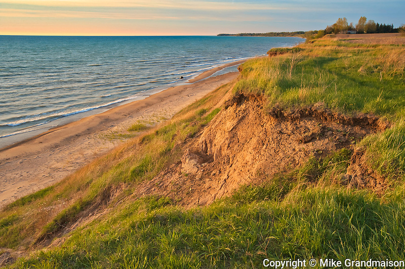Sandy beach and dunes on Lake Huron at sunset<br />