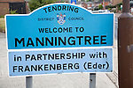 Road sign for the town of Manningtree, Tendring district council, Essex, England in partnership with Frankenberg Eder, Germany