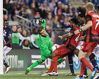 Foxborough, Massachusetts - April 27, 2016: In a Major League Soccer (MLS) match, the New England Revolution (blue/white) tied Portland Timbers (blue/red), 1-1, at Gillette Stadium.<br /> Cross yields own goal.