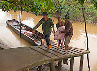 "Transporting Pigs by boat north of Can Tho, the hub of the Mekong Delta (Vietnamese: Đồng bằng Sông Cửu Long ""Nine Dragon river delta""), also known as the Western Region (Vietnamese: Miền Tây or the South-western region (Vietnamese: Tây Nam Bộ) is the region in southwestern Vietnam where the Mekong River approaches and empties into the sea through a network of distributaries. The Mekong delta region encompasses a large portion of southwestern Vietnam of 39,000 square kilometres (15,000 sq mi). The size of the area covered by water depends on the season.<br />