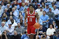 CHAPEL HILL, NC - FEBRUARY 25: Markell Johnson #11 of North Carolina State University dribbles the ball during a game between NC State and North Carolina at Dean E. Smith Center on February 25, 2020 in Chapel Hill, North Carolina.