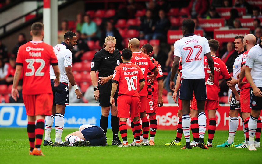 Walsall players surround Referee Trevor Kettle after his decision to send off Joe Edwards (right) for a challenge on Bolton Wanderers' Chris Taylor<br /> <br /> Photographer Kevin Barnes/CameraSport<br /> <br /> The EFL Sky Bet League One - Walsall v Bolton Wanderers - Saturday 17th September 2016 - Banks's Stadium - Walsall<br /> <br /> World Copyright &copy; 2016 CameraSport. All rights reserved. 43 Linden Ave. Countesthorpe. Leicester. England. LE8 5PG - Tel: +44 (0) 116 277 4147 - admin@camerasport.com - www.camerasport.com