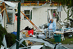 John Strickland, drinks a cup of coffee near the remains of his home, to the left, Friday, February 2, 2007, at Hawthorne Hills a mobile home park in DeLand. His kids and grandkids helped them sort through any belongings that had not gotten to wet. A deadly super cell of thunderstorms and tornadoes swept through Central Florida early today, killing at least 19 in Lake County, injuring up to three dozen in Volusia County and flattening dozens of homes across Volusia County. Damage in Volusia was estimated at more than $80 million. (Daytona Beach News-Journal, Chad Pilster)