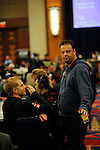Pokerstars Team Pro Canada members Greg De Bora and Pat Pezzin have a chat after Pezzin was eliminated in level 4.