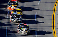Nov. 1, 2009; Talladega, AL, USA; NASCAR Sprint Cup Series driver Brad Keselowski (09), leads Dale Earnhardt Jr (88) during the Amp Energy 500 at the Talladega Superspeedway. Mandatory Credit: Mark J. Rebilas-