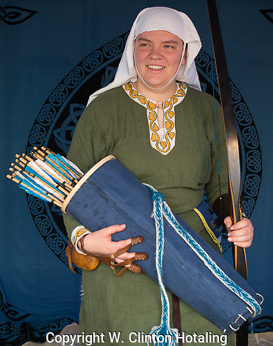Emma shows off her bow, handmade arrows and quiver.