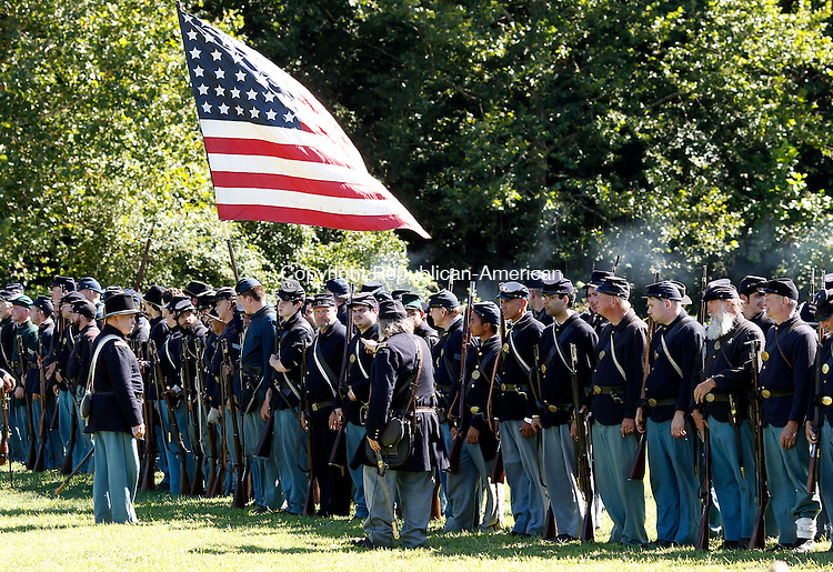 Woodbury, CT- 24 August 2013-082413CM02- Union soldiers line up following a civil war reenactment of the Battle of Reeds Bridge, Chickamauga, September 1863 at the Strong Preserve Park in Woodbury Saturday afternoon.  The history continues Sunday with camps opening to the public at 8:30a.m.  The reenactment of the Battle of Snodgrass Hill, Chickamauga, September 1863, will be held at 1:30p.m.  The camp will break at 3p.m.      Christopher Massa Republican-American