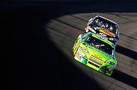 Mar 2, 2008; Las Vegas, NV, USA; NASCAR Sprint Cup Series driver Jeff Gordon (24) leads Martin Truex Jr during the UAW Dodge 400 at Las Vegas Motor Speedway. Mandatory Credit: Mark J. Rebilas-US PRESSWIRE