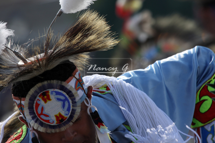 A teenager Native American Indian boy dancer at a Pow Wow at the Milwaukee Lakefront Indian Summer Festival, Wisconsin