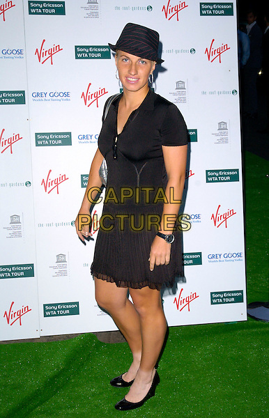 SVETLANA KUZNETSOVA.At a Sony Ericsson WTA Tour Pre-Wimbledon Party, The Roof Gardens, Kensington, London, England,.June 21st, 2007. full length black hta dredss wedges shoes.CAP/CAN.©Can Nguyen/Capital Pictures