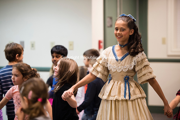 SOUTHBURY, CT - 20 November 2015-112015EC15--  Julianna Rodrigues, dressed as the Nutcracker's Clara, dances during an interactive Nutcracker performance with children who showed up at the Southbury Public Library Friday night. Members of the Main Street Ballet of Woodbury will perform the entire production December 5th and 6th at Pomperaug High School. Visit www.mainstreetballet.com for more information. Erin Covey Republican-American.