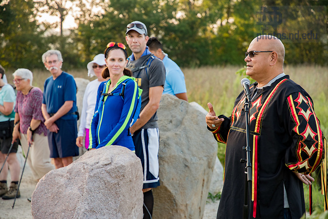 August 20, 2017; John P. Warren, Tribal Council chairman of the Pokagon Band of Potawatomi Indians speaks to ND Trail pilgrims at at Prophetstown Circle of Stones in Prophetstown State Park. The Circle of stones is a monument of 14 stones that honor the 14 native American tribes who once inhabited the land in the region. (Photo by Matt Cashore/University of Notre Dame)