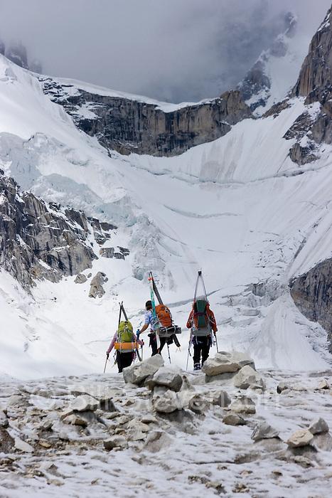 Three ski mountaineers walking on the Biafo glacier in the Karakoram Himalaya of Pakistan