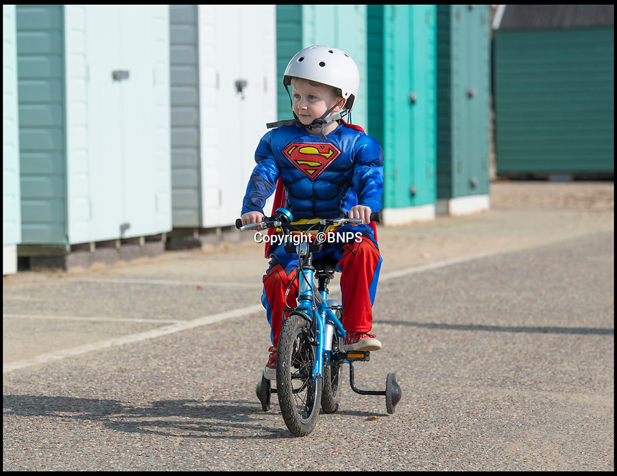 BNPS.co.uk (01202 558833)<br /> Pic: PhilYeomans/BNPS<br /> <br /> Superman Jenson Miles (4) takes his nervous first bike ride in front of all the family..<br /> <br /> First warm weekend of the year had the crowds shaking off the winter blues on Bournemouth seafront this weekend as the sun shone.
