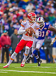9 November 2014: Kansas City Chiefs quarterback Alex Smith looks for an open receiver in the first quarter against the Buffalo Bills at Ralph Wilson Stadium in Orchard Park, NY. The Chiefs rallied with two fourth quarter touchdowns to defeat the Bills 17-13. Mandatory Credit: Ed Wolfstein Photo *** RAW (NEF) Image File Available ***
