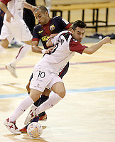 Caja Segovia's Sergio Gonzalez (r) and FC Barcelona Alusport's Igor Raphael Lima de Souza during Spanish National Futsal League match.November 24,2012. (ALTERPHOTOS/Acero) /NortePhoto