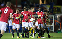 teammates celebrate with goal scorer Tosin Kehinde (right) of Manchester United during the U23 Premier League 2 match between Chelsea and Manchester United at the EBB Stadium, Aldershot, England on 18 September 2017. Photo by Andy Rowland.