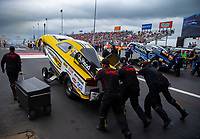 Apr 21, 2018; Baytown, TX, USA; Crew members push the car of NHRA funny car driver Jonnie Lindberg during qualifying for the Springnationals at Royal Purple Raceway. Mandatory Credit: Mark J. Rebilas-USA TODAY Sports