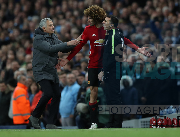 Jose Mourinho manager of Manchester United  and Marouane Fellaini of Manchester United after he was sent off during the English Premier League match at The Etihad Stadium, Manchester. Picture date: April 27th, 2016. Photo credit should read: Lynne Cameron/Sportimage