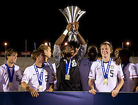 Kendall McIntosh (18) of the United States holds up the trophy after the finals of the CONCACAF Men's Under 17 Championship at Catherine Hall Stadium in Montego Bay, Jamaica. The United States defeated Canada, 3-0, in overtime