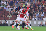 21.10.2014 Barcelona, Spain. UEFA Champions League matchday 3 Group 3. Picture show  Lasse Schone (F) and Ivan Rakitic (R) in action during game between FC Barcelona against Ajax at Camp Nou