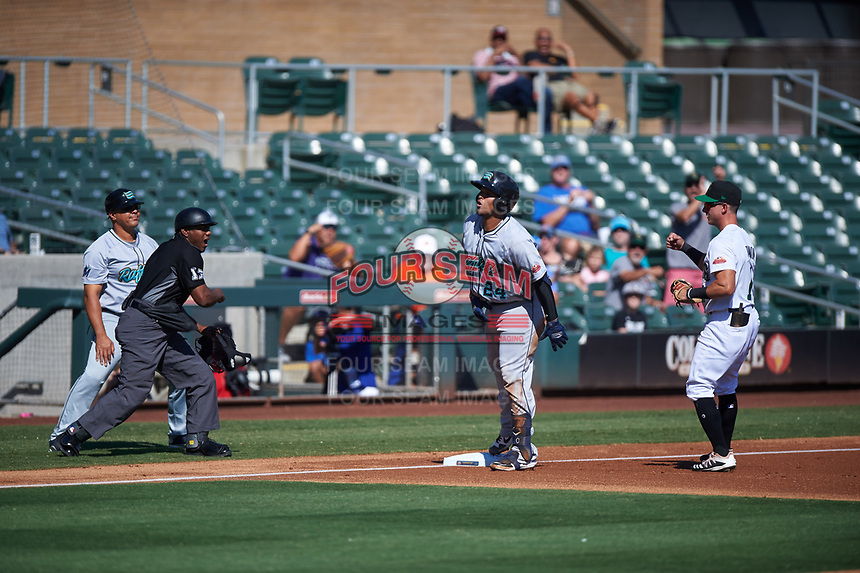 Salt River Rafters Ronaldo Hernandez (24) is called out by home plate umpire Malachi Moore after being tagged by third baseman Rylan Bannon (1) during the Arizona Fall League Championship Game against the Surprise Saguaros on October 26, 2019 at Salt River Fields at Talking Stick in Scottsdale, Arizona. The Rafters defeated the Saguaros 5-1. (Zachary Lucy/Four Seam Images)