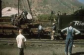 D&amp;RGW Durango yard crew loading draft gear from wrecked flat car #1293 on to flat car #6308.<br /> D&amp;RGW  Durango, CO