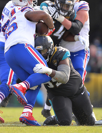 Jacksonville Jaguars defensive tackle Abry Jones (95) drops Buffalo Bills running back Mike Tolbert (35) for a 1 yard loss with 10:32 to play in the third quarter in a NFL Wildcard Playoff game Sunday, January 7, 2018 in Jacksonville, Fl.  (Rick Wilson/Jacksonville Jaguars)