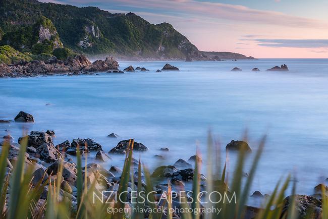 Pink twilight on rocky beach near Punakaiki, Paparoa National Park, Buller Region, West Coast, New Zealand, NZ