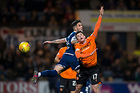 8th November 2019; Dens Park, Dundee, Scotland; Scottish Championship Football, Dundee Football Club versus Dundee United; Jamie Robson of Dundee United competes in the air with Declan McDaid of Dundee  - Editorial Use