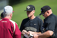 Wake Forest Demon Deacons head coach Tom Walter (16) exchanges lineup cards with Florida State Seminoles head coach Mike Martin (left) and home plate umpire John Haggerty (right) at David F. Couch Ballpark on April 16, 2016 in Winston-Salem, North Carolina.  The Seminoles defeated the Demon Deacons 13-8.  (Brian Westerholt/Four Seam Images)