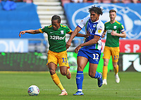 Preston North End's Daniel Johnson holds off Wigan Athletic's Reece James<br /> <br /> Photographer David Shipman/CameraSport<br /> <br /> The EFL Sky Bet Championship - Wigan Athletic v Preston North End - Monday 22nd April 2019 - DW Stadium - Wigan<br /> <br /> World Copyright © 2019 CameraSport. All rights reserved. 43 Linden Ave. Countesthorpe. Leicester. England. LE8 5PG - Tel: +44 (0) 116 277 4147 - admin@camerasport.com - www.camerasport.com