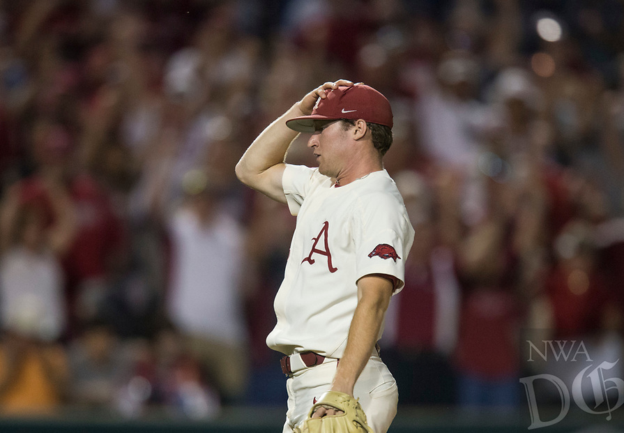 NWA Democrat-Gazette/BEN GOFF @NWABENGOFF<br /> Barrett Loseke, Arkansas pitcher, reacts after throwing the final strike to end the game Saturday, June 9, 2018, during game one of the NCAA Super Regional against South Carolina at Baum Stadium in Fayetteville.