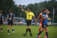 Kansas City, MO - Saturday May 07, 2016: The referee signals a corner kick during the game between Houston Dash and FC Kansas City during a regular season National Women's Soccer League (NWSL) match at Swope Soccer Village. Houston won 2-1.