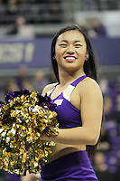 SEATTLE, WA - DECEMBER 18: Washington cheerleader Becca Kuhn entertained fans during a timeout break against Western Michigan.  Washington won 92-86 over Western Michigan at Alaska Airlines Arena in Seattle, WA.