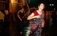 Guests escape from the Taj Mahal Palace Hotel after multiple terrorist attacks were launched in Mumbai on 26/11/2008..