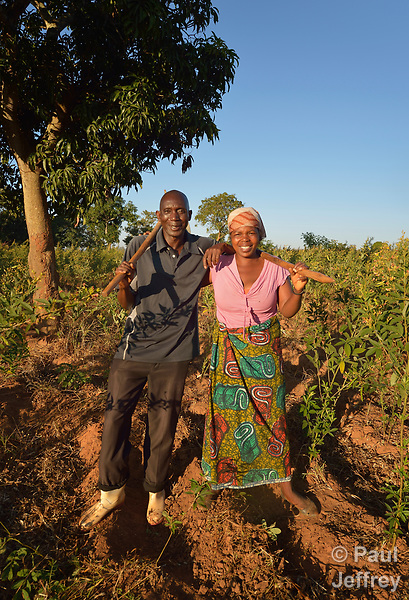 Pressing Moyo and his wife Mariet Hara pose on their farm in Edundu, Malawi. They and other farmers in the village have benefited from intercropping and crop rotation practices they learned from the Malawi Farmer-to-Farmer Agro-Ecology project of the Ekwendeni Mission Hospital AIDS Program, a program of the Livingstonia Synod of the Church of Central Africa Presbyterian.