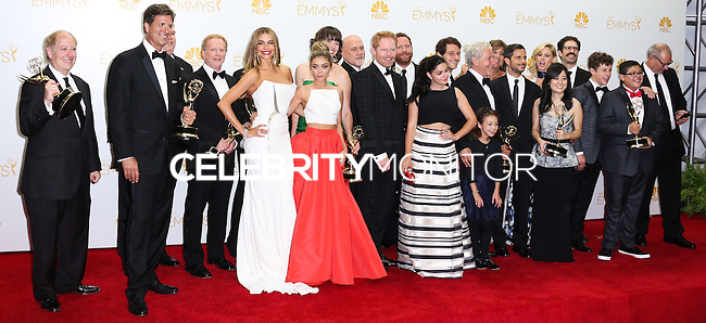 LOS ANGELES, CA, USA - AUGUST 25: Actors Sarah Hyland, Sofía Vergara, Aubrey Anderson-Emmons, Julie Bowen, Ariel Winter, Jesse Tyler Ferguson, Nolan Gould, Rico Rodriguez, Eric Stonestreet and Ed O'Neill with Show Producers, winners of the Outstanding Comedy Series Award for 'Modern Family' pose in the press room at the 66th Annual Primetime Emmy Awards held at Nokia Theatre L.A. Live on August 25, 2014 in Los Angeles, California, United States. (Photo by Celebrity Monitor)