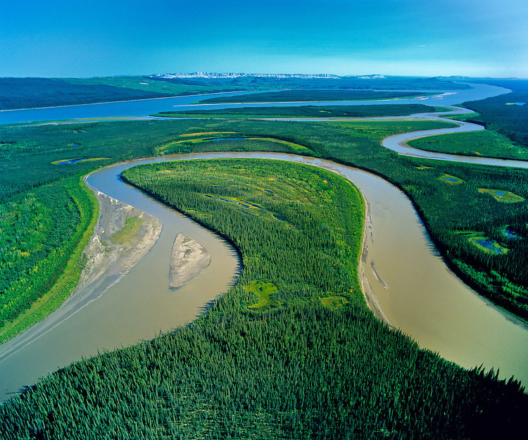 Confluence of Carcajou River and Mackenzie River. Mackenzie Valley, NWT 2005<br /> The Caracajou River winds back and forth creating this oxbow of wetlands as it winds it way to join the Mackenzie flowing north to the Beaufort Sea. This region, almost entirely pristine, and the third largest watershed basin in the World, will be directly impacted by the proposed Mackenzie Valley National Gas Pipeline to fuel the energy needs of the Alberta Oil Sands mega-project.
